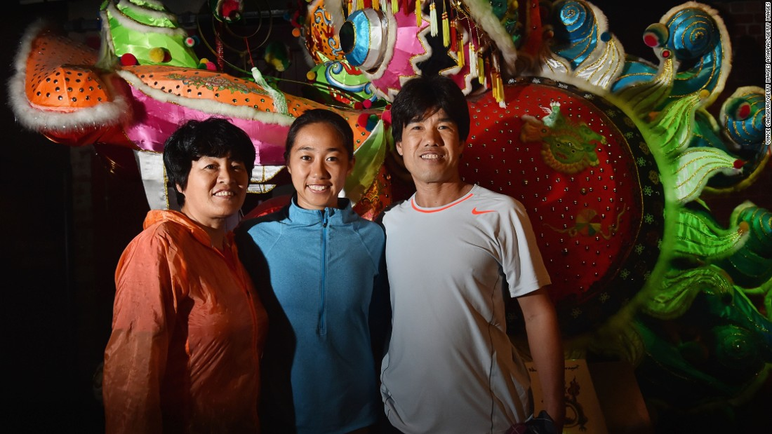 Zhang brought her mother Wang Feng Qin (left) and father Zhang Zhi Qiang (right) to Melbourne because she feared it could be her final top-level tournament.