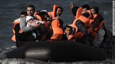Refugees and migrants cross by boat the Aegean sea from Turkey, to reach the Greek island of Lesbos, on October 31, 2015. AFP PHOTO / ARIS MESSINIS        (Photo credit should read ARIS MESSINIS/AFP/Getty Images)