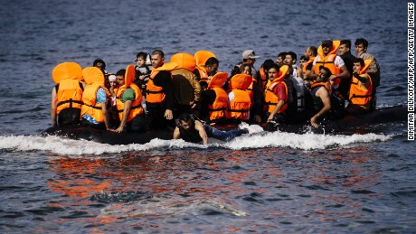 Migrants arrive on the Greek island of Lesbos after crossing the Aegean sea from Turkey October 18, 2015.