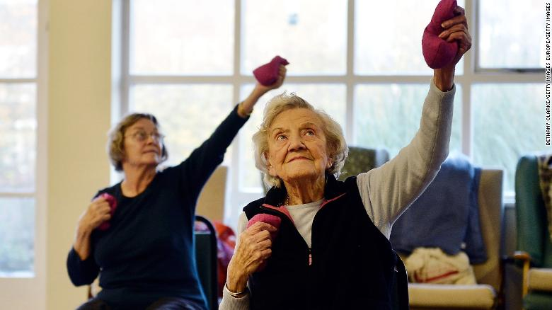 BARNET, ENGLAND - DECEMBER 04:  Elderly people take part in an exercise class at the AgeUK Ann Owens Centre on December 4, 2013 in Barnet, England. AgeUK are a nationwide charity organisation that work with the growing number of elderly people throughout the UK. They run a number of activities for the elderly ranging from cookery classes to Tai Chi and try to improve the lives of pensioners from loneliness to fitness. (Photo by Bethany Clarke/Getty Images)