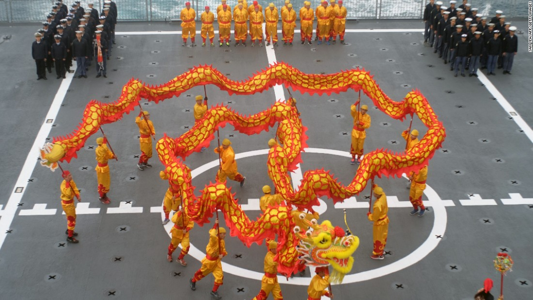 Taiwanese navy sailors watch celebrations marking the Lunar New Year on the deck of a Panshi supply ship after the drill on January 27.