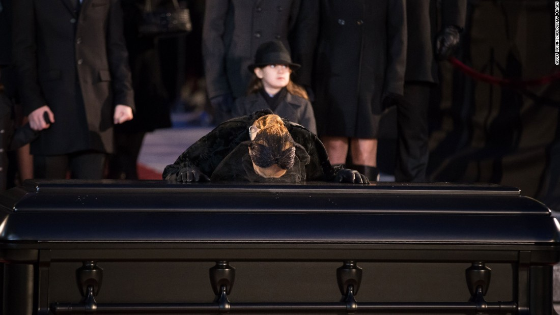"Singer Celine Dion kisses the casket of her husband, René Angélil, after <a href=""http://www.cnn.com/2016/01/23/entertainment/ren-anglil-funeral-feat/index.html"" target=""_blank"">his funeral service</a> on Friday, January 22. Angélil died of throat cancer on January 14. He was 73."