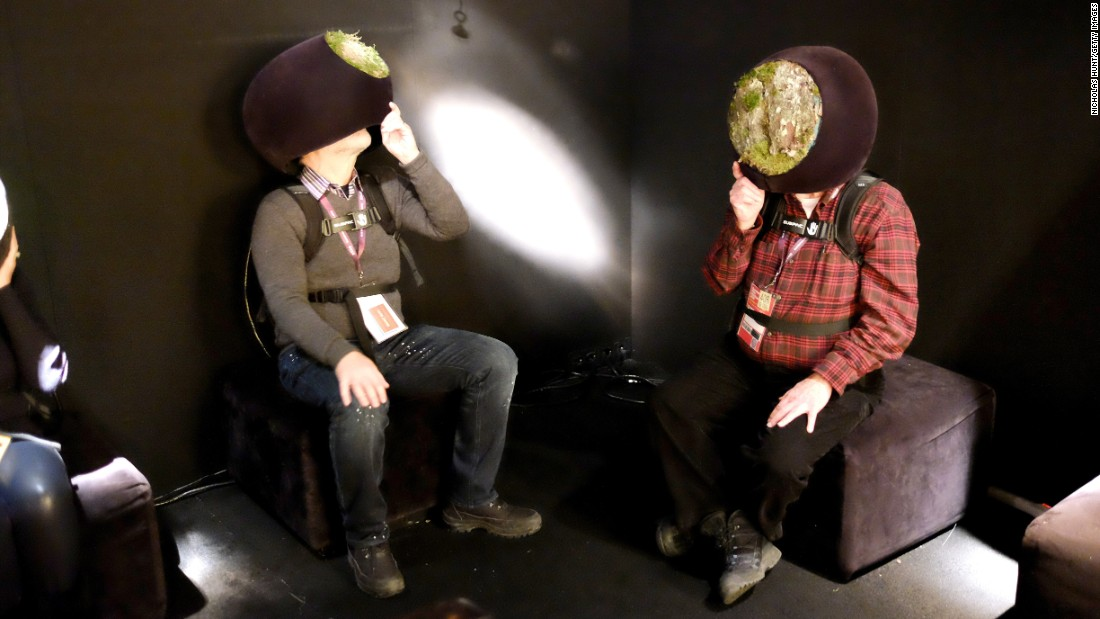 People use virtual-reality headsets during a Sundance Film Festival event held Monday, January 25, in Park City, Utah.