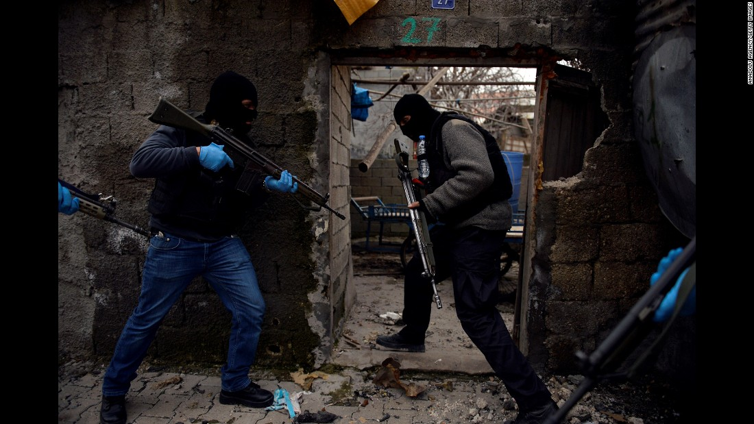 Security forces search a building in Sirnak, Turkey, during a counterterrorism operation on Saturday, January 23.