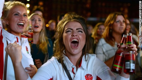 England fans react as they watch the England v Wales rugby union game on a giant television screen at a fanzone in Cardiff, Wales, on September 26, 2015, during the 2015 Rugby World Cup. AFP PHOTO / GABRIEL BOUYS        (Photo credit should read GABRIEL BOUYS/AFP/Getty Images)
