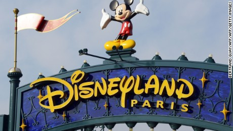 A photo taken on August 13, 2015 shows a sign above the entrance at Disneyland Paris in Marne-la-Vallee. AFP PHOTO / BERTRAND GUAY        (Photo credit should read BERTRAND GUAY/AFP/Getty Images)