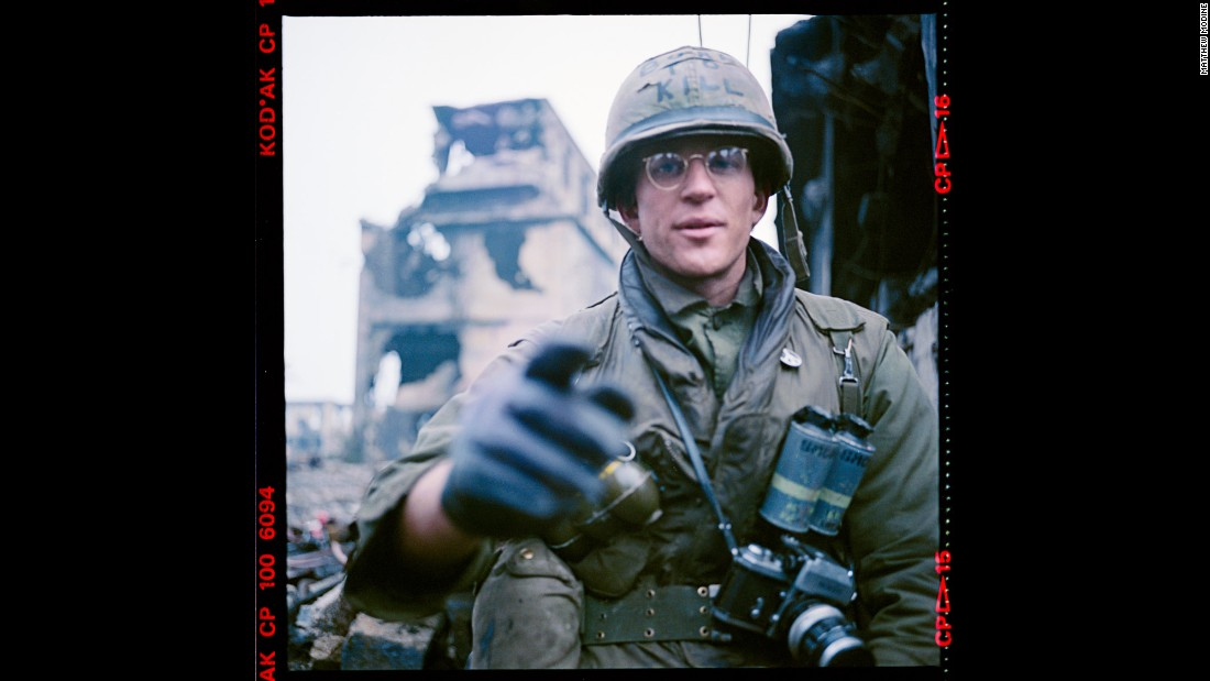 "This self-portrait/exposure test was taken by actor Matthew Modine in November 1985, as he appeared on the set of Stanley Kubrick's ""Full Metal Jacket."" ""The English weather was getting wet, nasty and cold -- difficult for scenes where you need to believe we are in Vietnam,"" Modine said. ""I had gloves on because the weather was in the 30s -- too cold for Marine Corps-issue combat fatigues. In the background, you can see one of Beckton Gas Works' large coal bins -- artistically 'destroyed' for Stanley's production."""