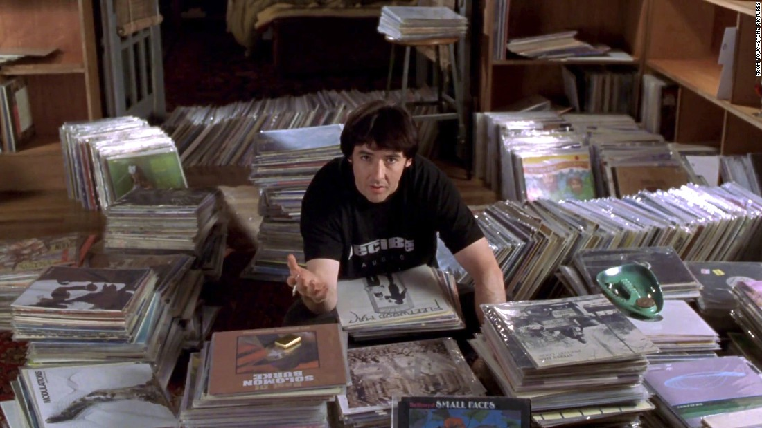 "In ""High Fidelity,"" John Cusack's character takes the occasion of a breakup to recount his many relationship disasters. Guess what the common denominator is?"