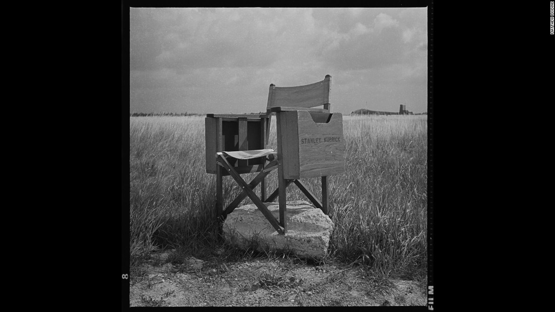"Kubrick's director's chair sits at Bassingbourn Airfield, England, in 1986. ""I don't know why I stuck it on this chunk of concrete,"" Modine said. ""I thought it was funny. With Stanley's passing, the image has taken on an unexplainable significance. It is with this photo that I discovered that photographs continue to develop over time."""