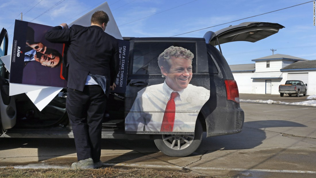 Jonathan Van Norman, a field staffer for U.S. Sen. Rand Paul, loads campaign material into a van after the Republican presidential candidate attended a town-hall meeting in Knoxville, Iowa, on Friday, January 29.