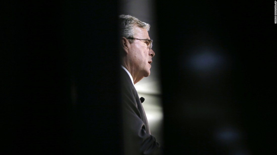 Republican presidential candidate Jeb Bush is seen through a curtain as he speaks at an event in Des Moines, Iowa, on Wednesday, January 27.