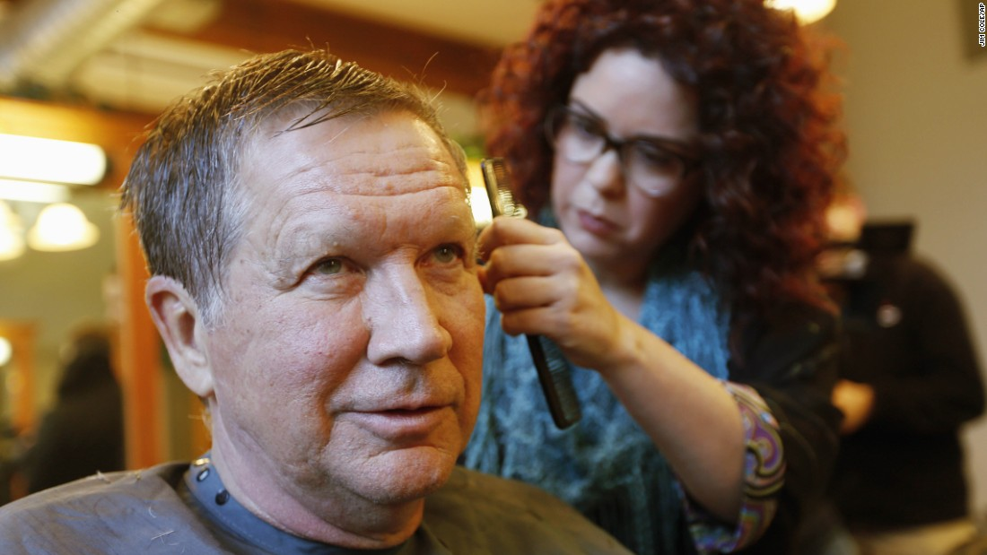 Ohio Gov. John Kasich, a Republican presidential candidate, has his hair cut in Manchester, New Hampshire, on Monday, January 25.