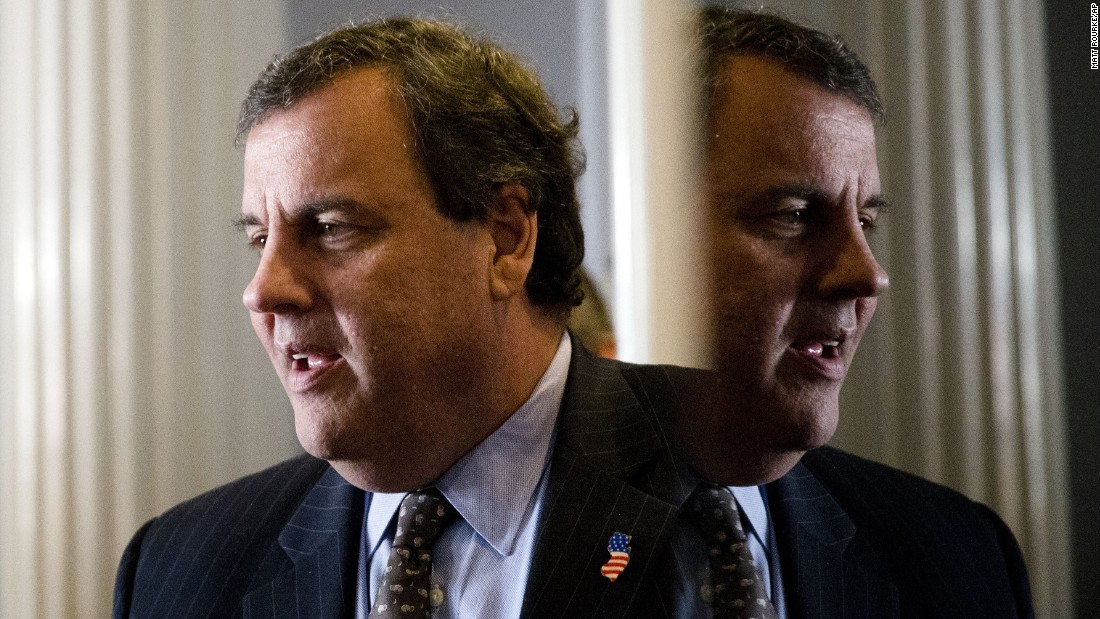 New Jersey Gov. Chris Christie, a Republican presidential candidate, talks with a supporter before a news conference in Concord, New Hampshire, on Monday, January 25.