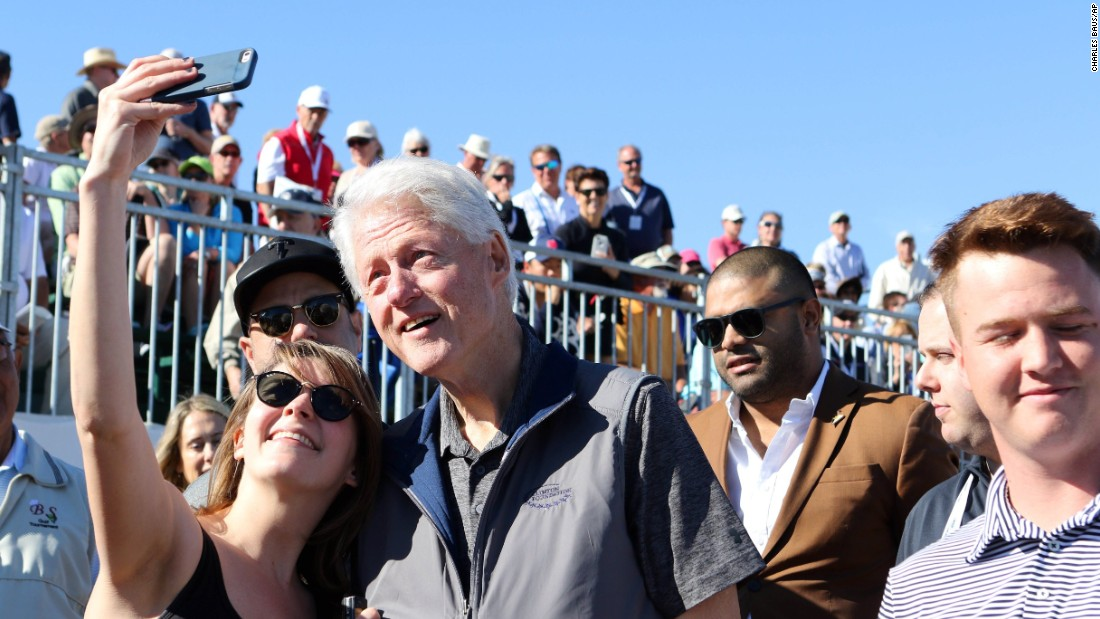Former U.S. President Bill Clinton poses for a selfie during a pro golf event in La Quinta, California, on Sunday, January 24.
