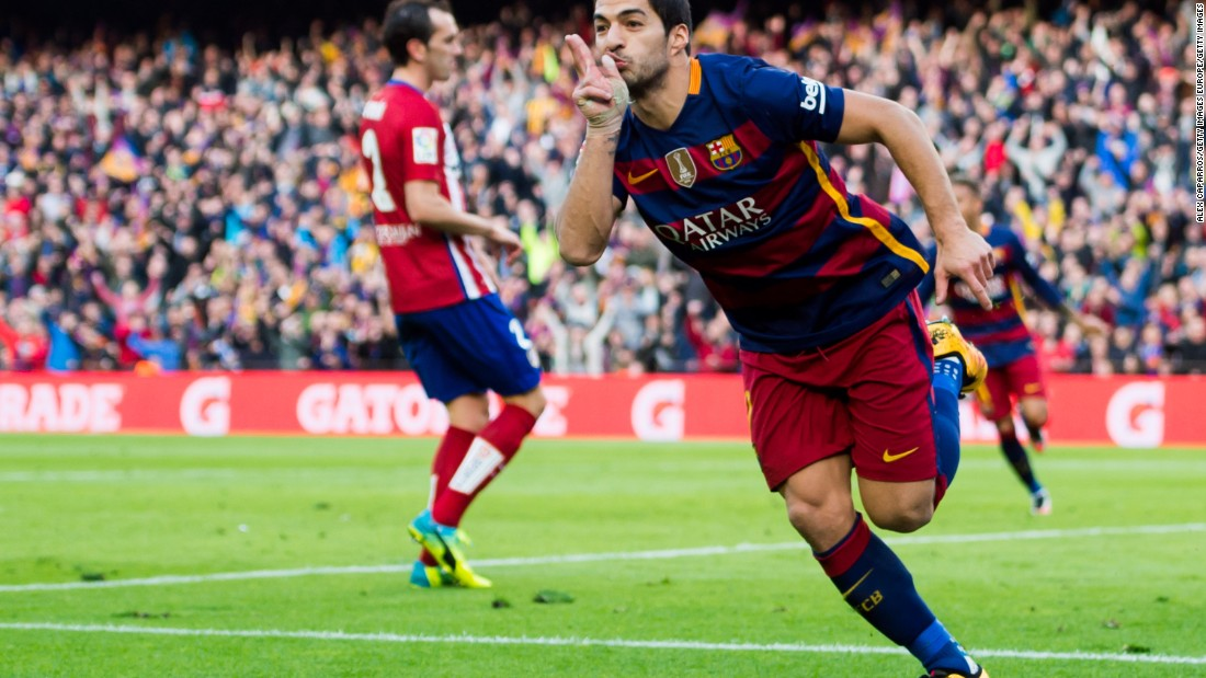 Luis Suarez celebrates after scoring his team's second and decisive goal in Barcelona's 2-1 victory over Atletico.