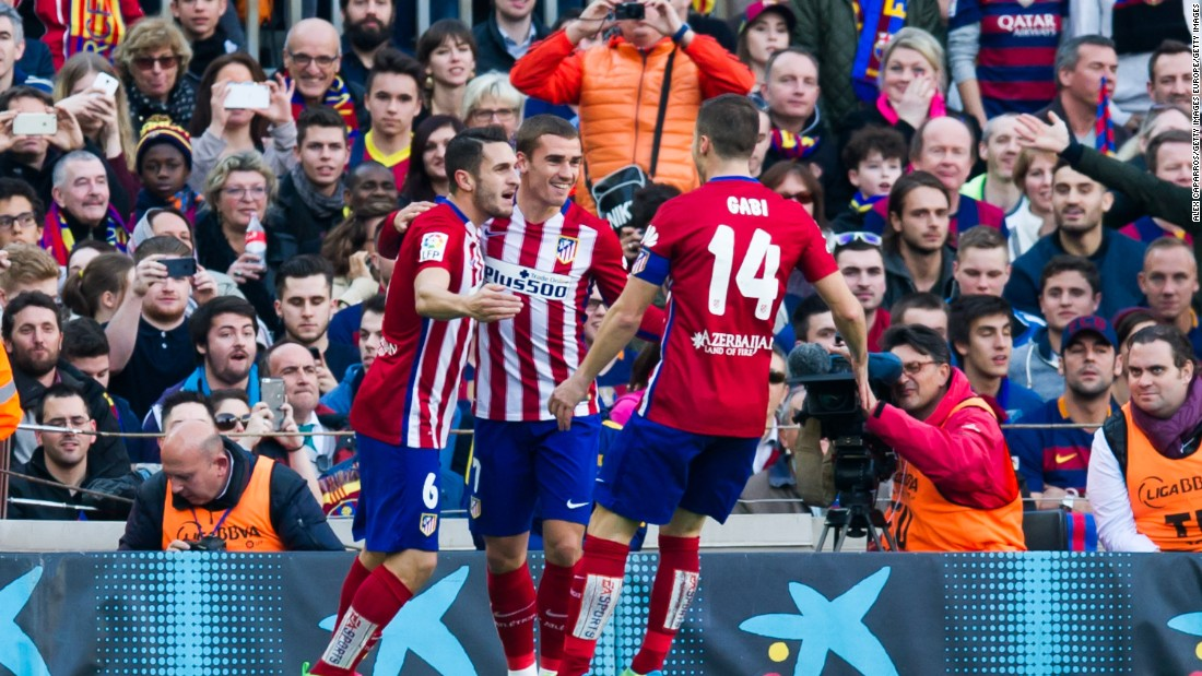 Koke (left) gets the plaudits from teammates Antoine Griezmann (C) and Gabi after scoring a fine opener for Atletico.