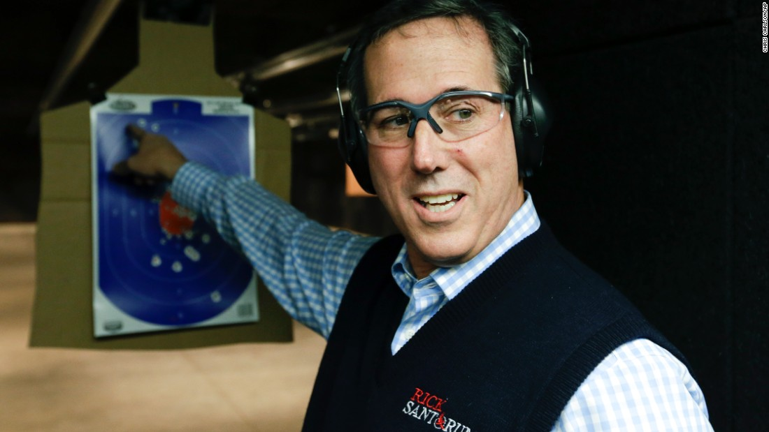 Republican presidential candidate Rick Santorum points to his target during a campaign stop at a shooting range in Boone, Iowa, on Saturday, January 30.