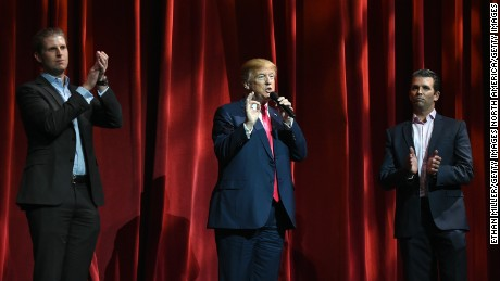 LAS VEGAS, NV - JANUARY 21:  Republican presidential candidate Donald Trump (C) speaks as his sons Eric Trump (L) and Donald Trump Jr. (R) look on during the Outdoor Channel and Sportsman Channel's 16th annual Outdoor Sportsman Awards at The Venetian Las Vegas during the 2016 National Shooting Sports Foundation's Shooting, Hunting, Outdoor Trade (SHOT) Show on January 21, 2016 in Las Vegas, Nevada.  (Photo by Ethan Miller/Getty Images)