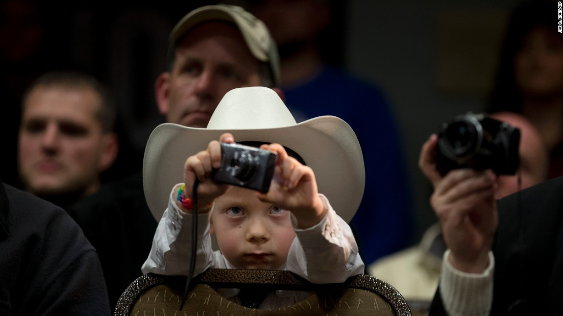 McCoy Wicker, 5, takes pictures of U.S. Sen. Marco Rubio during a presidential campaign rally in Council Bluffs, Iowa, on Saturday, January 30.