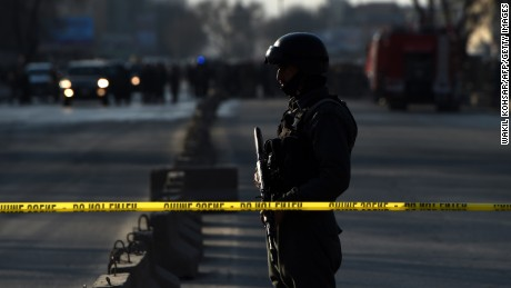 Security was tight near the site of Monday's attack on a police headquarters in Kabul, Afghanistan.