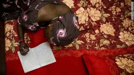 Khadija Gudaji works on her novel while laying in bed at her home in Kano, Northern Nigeria. For one time online use only for cnn.com article in association with publicaiton of DIAGRAM OF THE HEART. All other usage must be requested. For one time online use only for cnn.com article in association with publication of DIAGRAM OF THE HEART. All other usage must be requested.