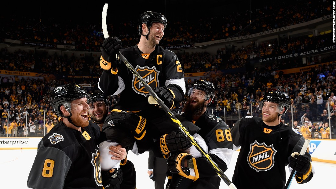 John Scott is carried by his Pacific Division teammates after they won the NHL All-Star Game final on Sunday, January 31. Scott was named Most Valuable Player, ending a storybook weekend for the 6-foot-8 enforcer who the fans voted into the game. Scott has only five goals in 285 NHL games, but he scored twice in the All-Star semifinal.