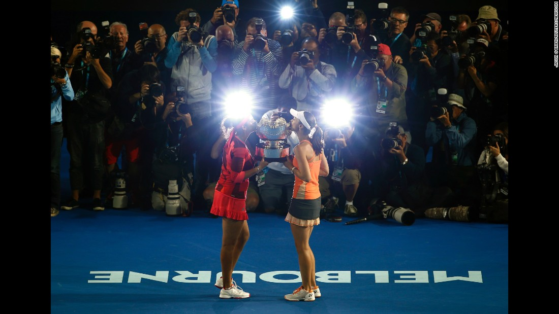 Sania Mirza, left, and Martina Hingis kiss their trophy after they won the doubles title at the Australian Open on Friday, January 29. Last year, the team won Wimbledon and the U.S. Open.