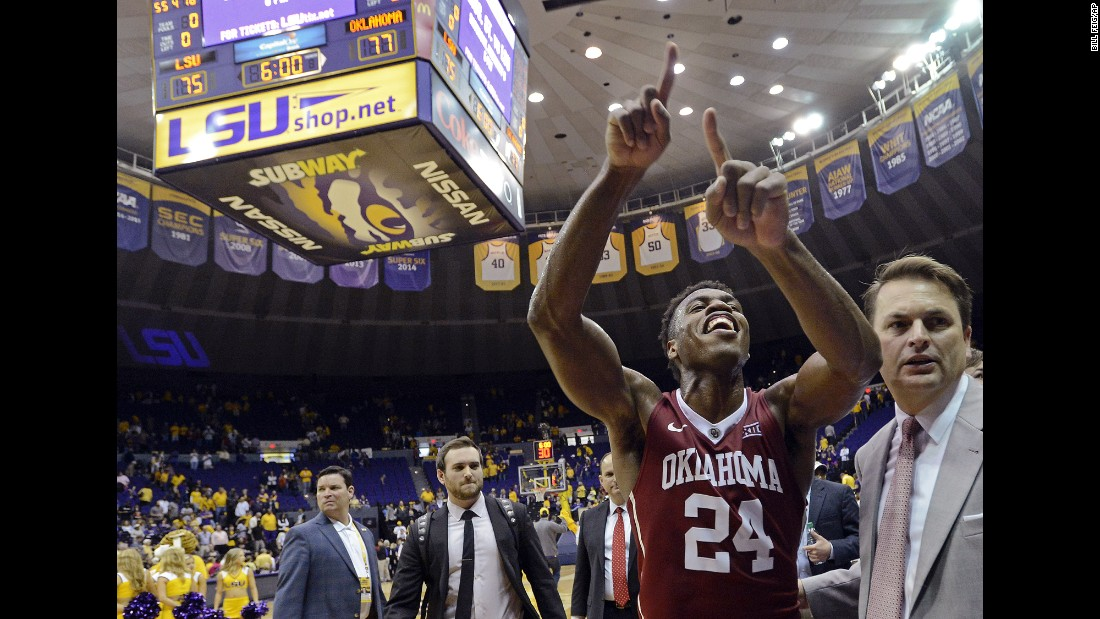 Oklahoma guard Buddy Hield celebrates after his team defeated LSU in Baton Rouge, Louisiana, on Saturday, January 30. The top-ranked Sooners won 77-75.