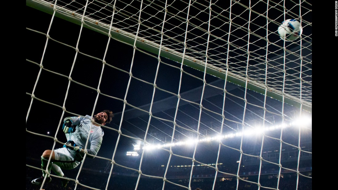 Iago Herrerin, the goalkeeper for Athletic Bilbao, clears the ball over the bar during a Copa del Rey match against FC Barcelona on Wednesday, January 27. Barcelona won the match 3-1 to clinch a spot in the semifinals of the Spanish tournament.