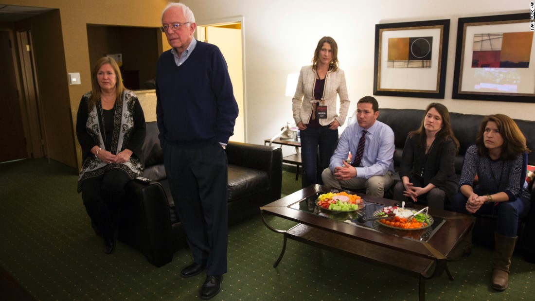 Sanders watches caucus returns at his hotel room in Des Moines.