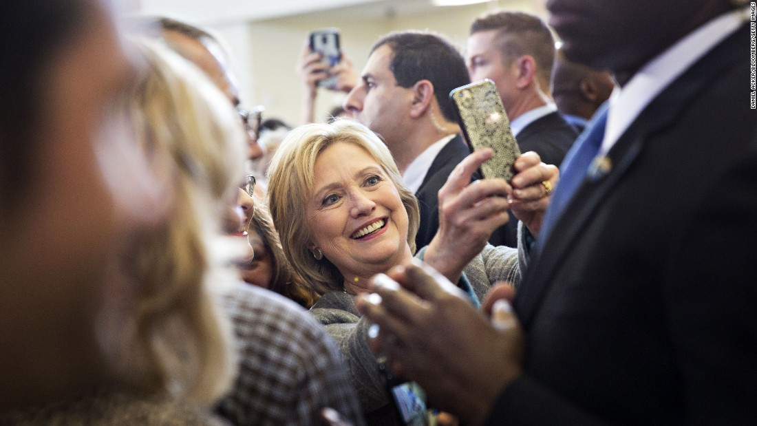 Democratic presidential candidate Hillary Clinton takes a selfie during a campaign event in Council Bluffs, Iowa, on Sunday, January 31.