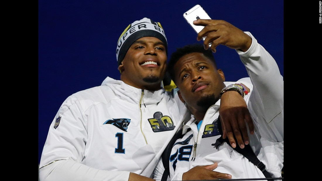 Carolina Panthers running back Jonathan Stewart snaps a photo with quarterback Cam Newton during a Super Bowl event in San Jose, California, on Monday, February 1. The Panthers will play Denver on February 7.