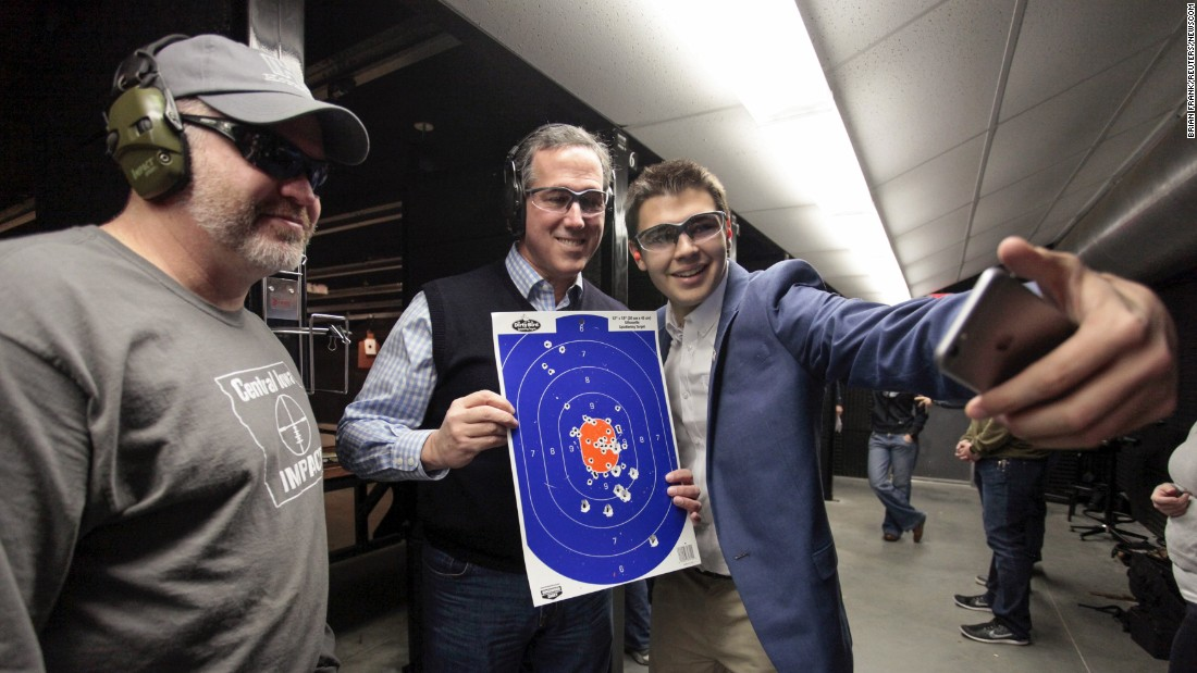 Republican presidential candidate Rick Santorum, second from right, poses for a selfie at a shooting range in Boone, Iowa, on Saturday, January 30.