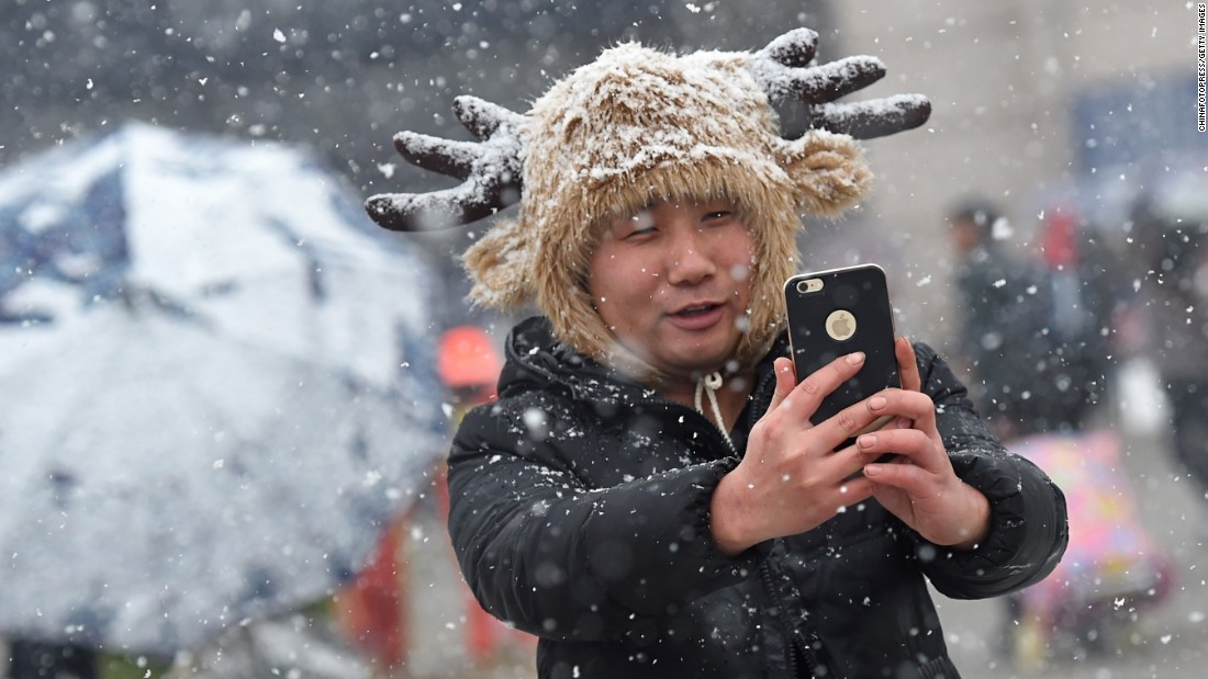 "A traveler takes selfies in the show at a railway station in Wuhan, China, on Sunday, January 31. <a href=""http://www.cnn.com/2016/01/27/living/gallery/look-at-me-selfies-0127/index.html"" target=""_blank"">See 21 selfies from last week</a>"