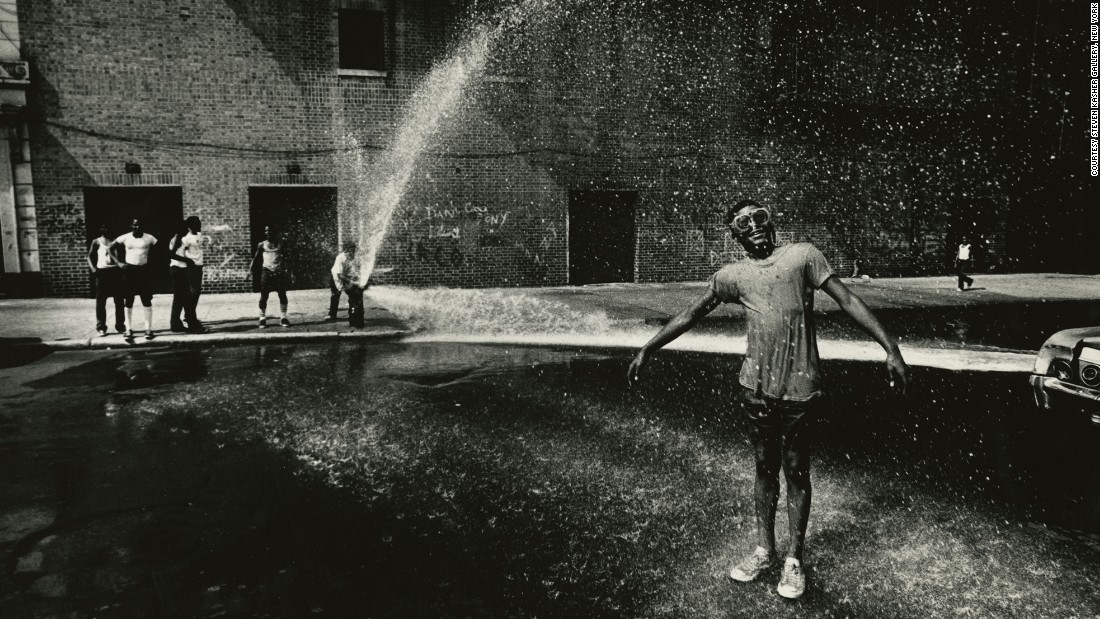 "On a hot summer day in 1961, Louis Draper took his camera outside to snap this gleeful moment of kids playing in the shooting spray of a New York City fire hydrant. Although Draper died in 2002 and was not widely famous during his lifetime, his photography -- mostly of everyday African-Americans -- has gained him a newfound appreciation in recent years. The <a href=""http://www.stevenkasher.com/exhibitions/louis-draper"" target=""_blank"">Steven Kasher Gallery </a>in New York is exhibiting more than 75 of his photos through February 20."