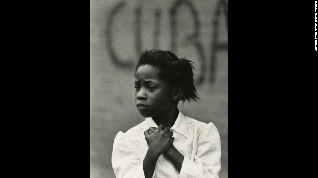 "One of Draper's recurring themes was the juxtaposition of human subjects with street signs, posters or graffiti. This image, ""Girl and Cuba,"" was captured in Philadelphia in 1968."