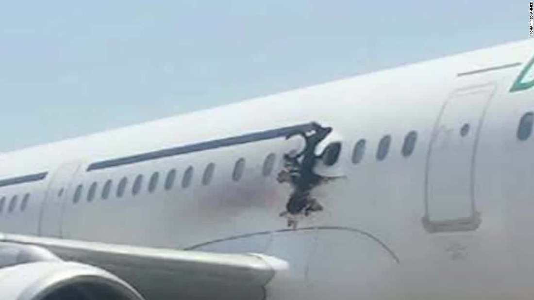 Airport workers seen with laptop used in Somalia in-flight jet blast