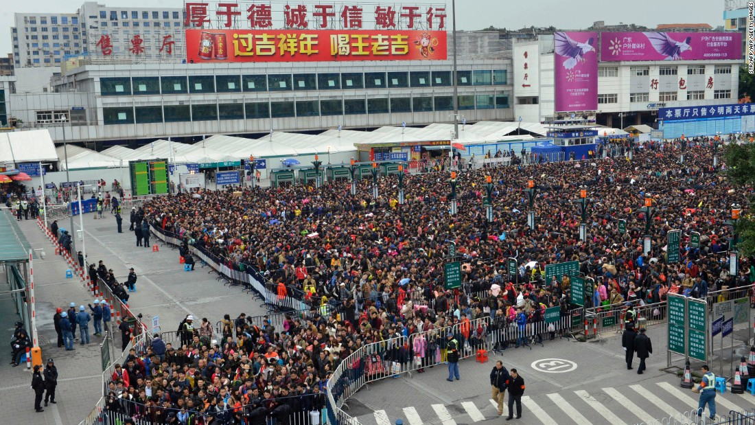 Guangzhou Railway Corp said Tuesday that 38,000 passengers were stuck, but China's People's Daily said the crowd was much bigger -- as many as 100,000.