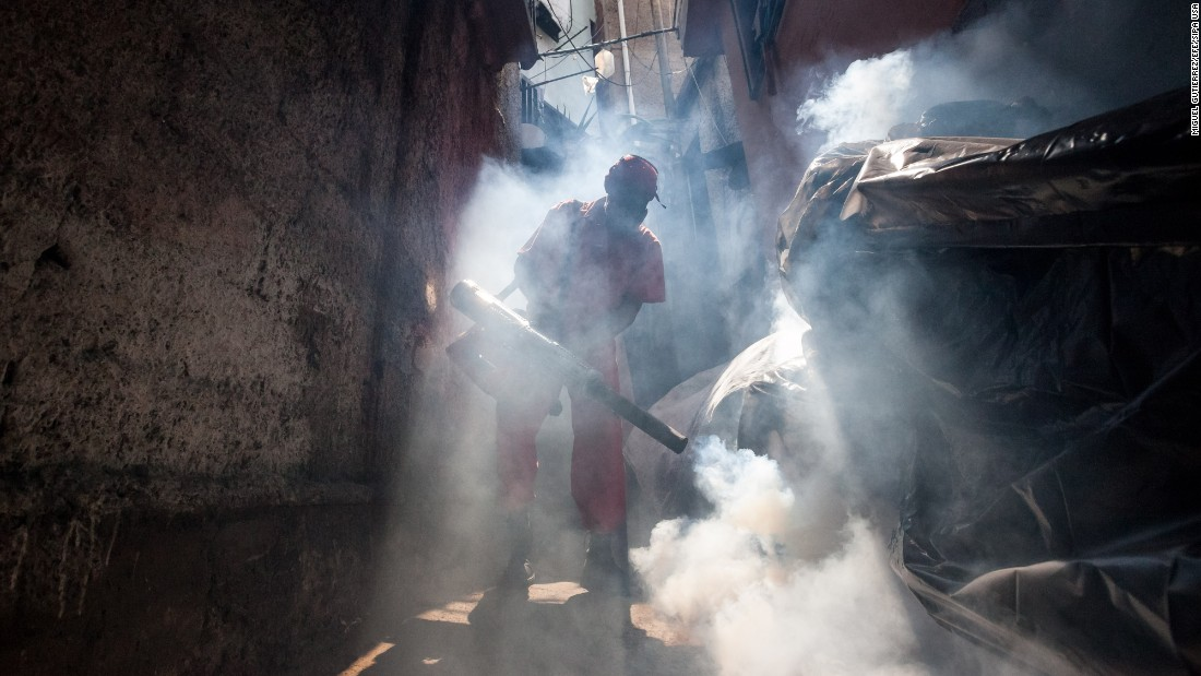 A health worker fumigates an area in Caracas, Venezuela, on Tuesday, February 2.