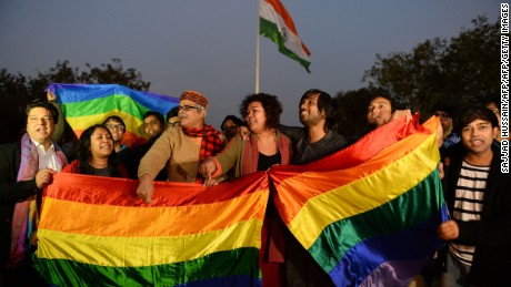 Indian gay rights activists celebrate after the country's Supreme Court agreed to review a decision which criminalises gay sex in New Delhi on February 2, 2016.