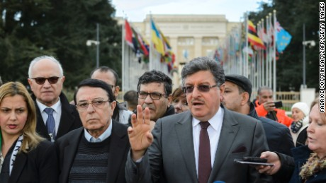 Members of the main Syrian opposition delegation speak outside United Nations offices in Geneva on Tuesday.