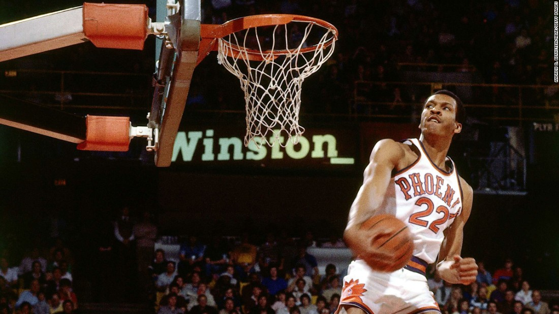 "Larry Nance glides to the rim during the NBA's first Slam Dunk Contest, which was held in Denver on January 28, 1984. Nance defeated ""Dr. J"" Julius Erving in the finals of a nine-man competition that also included future Hall of Famers Dominique Wilkins and Clyde Drexler. Over the past three decades, the NBA's Slam Dunk Contest has provided some of the most iconic moments in league history, dazzling viewers with its unique blend of athleticism and showmanship. It is traditionally held midseason as part of the league's All-Star Game festivities."