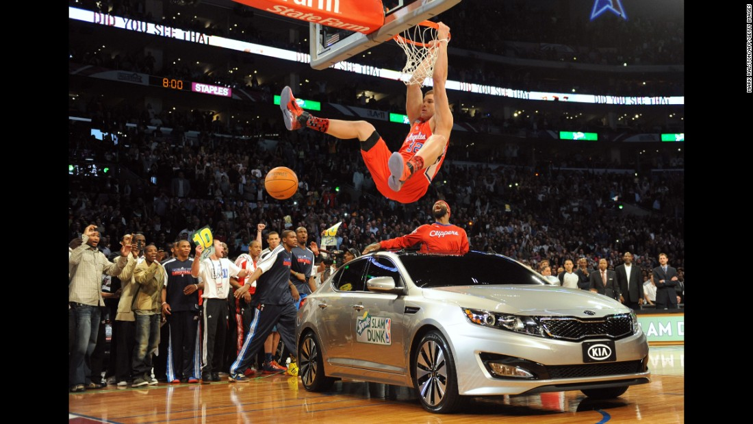 "With a choir singing R. Kelly's ""I Believe I Can Fly,"" Griffin jumped over the hood of car and finished an alley-oop pass from teammate Baron Davis, who was poking out of the sunroof."