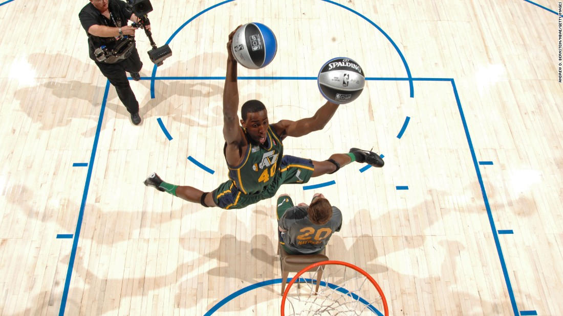 Perhaps the standout dunk from Evans' victory was when he jumped over teammate Gordon Hayward, caught two balls and dunked one with each hand. He later dunked over comedian Kevin Hart while paying homage to former Jazz great Karl Malone.