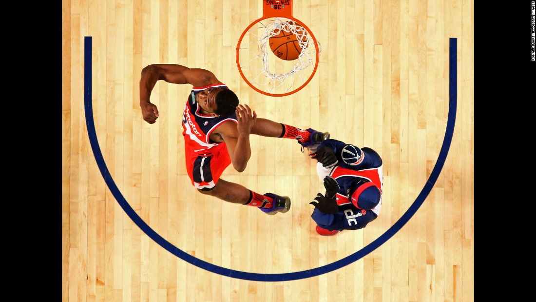 "The contest took on an unusual team format this year, with ""battle rounds"" pitting one Eastern Conference dunker against one Western Conference dunker. At the end, the fans voted on John Wall as the ""Dunker of the Night."" He had jumped over Wizards mascot G-Man for a ferocious reverse dunk. They celebrated with the ""Nae Nae"" dance."
