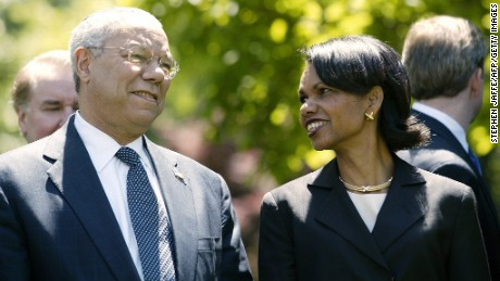 US Secretary of State Colin Powell (L) talks with National Security Advisor Condoleezza Rice (R) prior to US President George W. Bush and Jordan's King Abdullah II speaking in the Rose Garden at the White House 06 May 2004 in Washington, DC.