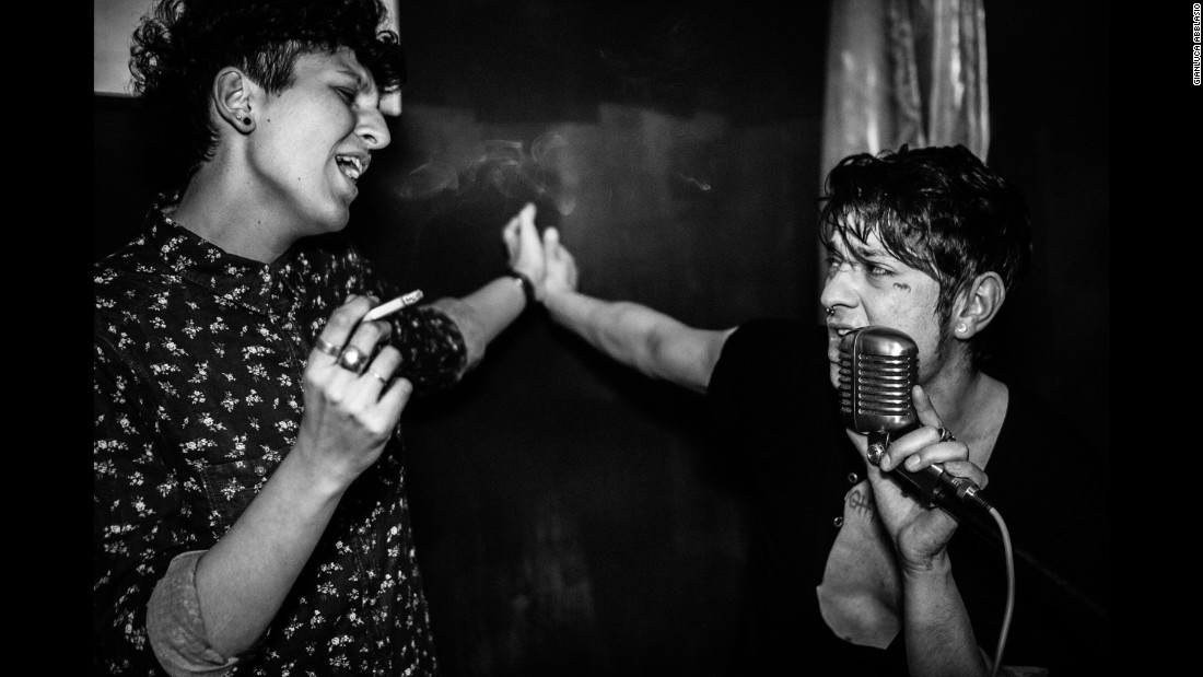 "A young Italian named Dario, right, performs at a party in Rome in 2015. Photographer Gianluca Abblasio has been documenting the aspiring rock star's life in a photo series called ""I Am Dario."""