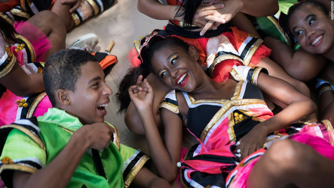 Young revelers joke with each other as they lie in the shade during a Carnival block parade in Olinda, Brazil, on February 5.