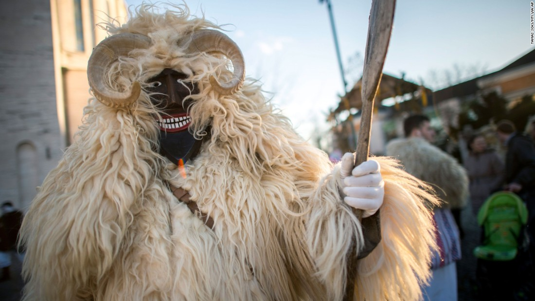 A reveler in a traditional costume walks in a Carnival parade in Mohacs, Hungary, on February 4.