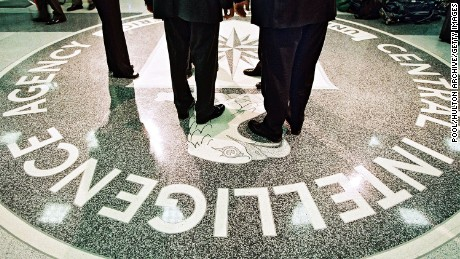 386984 06: President George W. Bush, Central Intelligence Agency Director George Tenet and others stand on the seal of the Agency March 20, 2001 at the CIA Headquarters in Langley, Virginia. Bush toured the facility and met some of the Agency''s employees. (Pool Photo by David Burnett/Newsmakers)